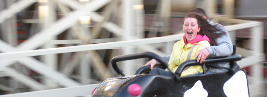 Photo of a girl smiling on a rolle rcoaster